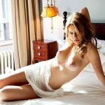 Camille-Rowe-Strips-In-Sunlight-07-580x435