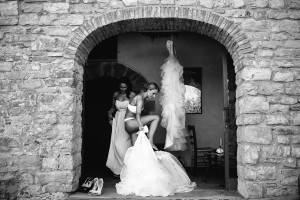 Naked bride putting on her dress For Her wedding in Tuscany