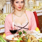 Girl in vintage dress in the restaurant. elegant pretty woman in vintage evening dress waiting alone at the restaurant bar
